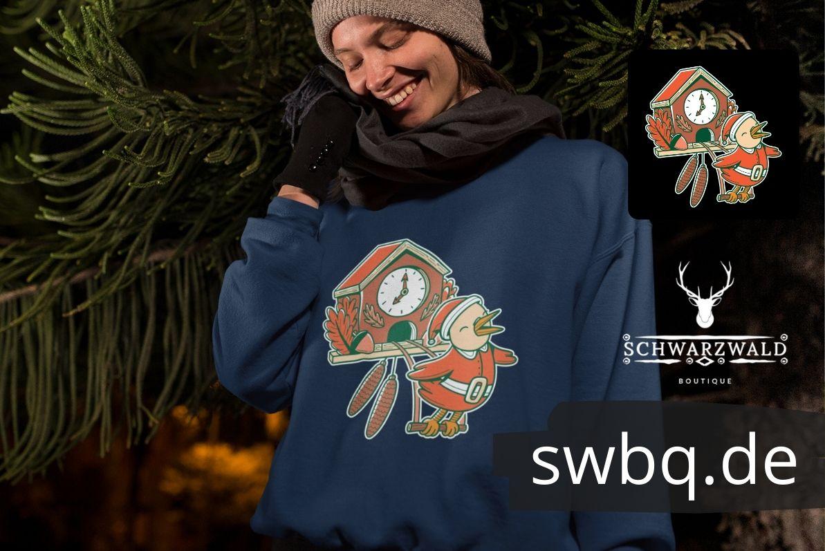 Schwarzwald geschenk - auf dem motiv kommt ein kuckuck im weihnachtsmann kostuem aus einer schwarzwaelder kuckucksuhr - weihnachten im schwarzwald