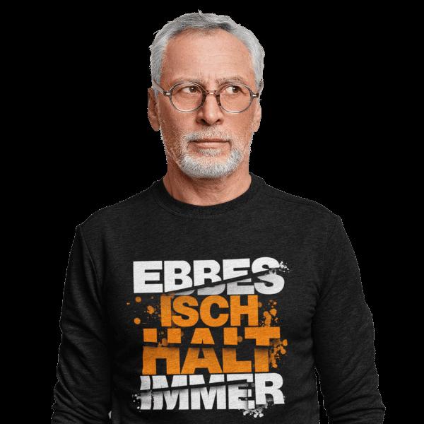 grauhaariger mann mit schwarzem langarm t-shirt mit alemannischem spruch