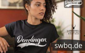 frau mit locken und schwarzem t-shirt mit logo denzlingen